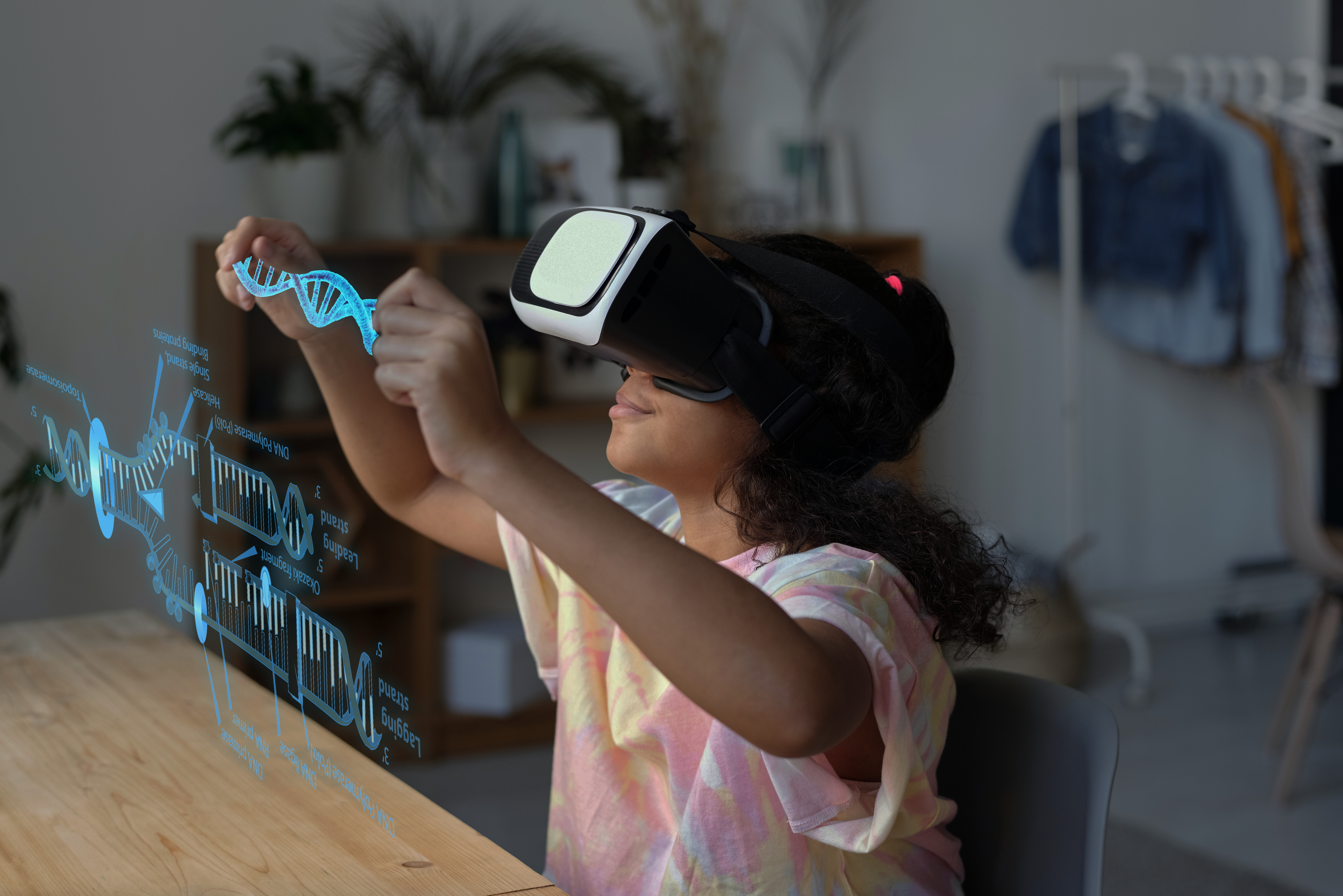 Girl wearing VR headset, learning about DNA through immersive learning in virtual reality.