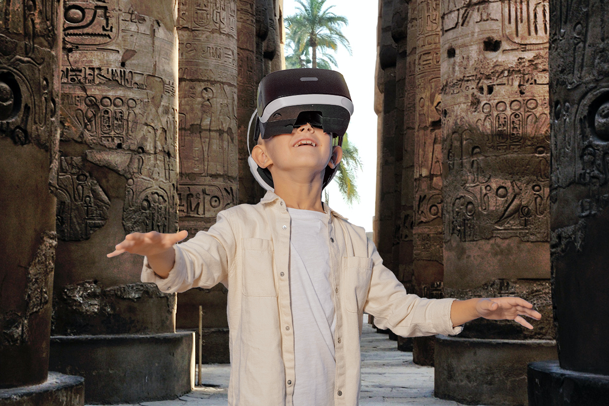 Boy wearing VR headset. His environment in VR is in acient Egypt.